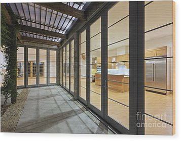 Modern Home Kitchen Through Glass Doors Wood Print by Jeremy Woodhouse