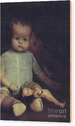 Old Dolls Sitting On Wooden Table Wood Print by Sandra Cunningham