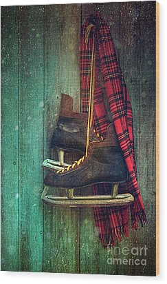 Old Ice Skates Hanging On Barn Wall Wood Print by Sandra Cunningham