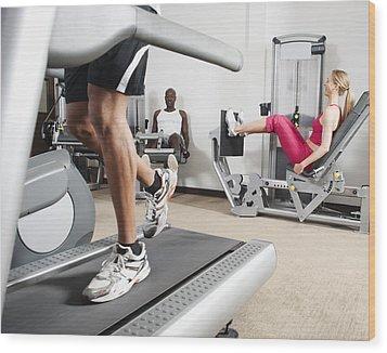 People Exercising In Health Club Wood Print by Erik Isakson