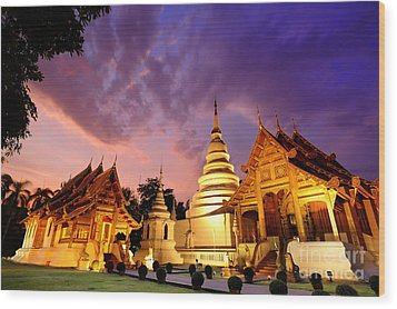 Phra Singh Temple Twilight Time Wood Print by Panupong Roopyai