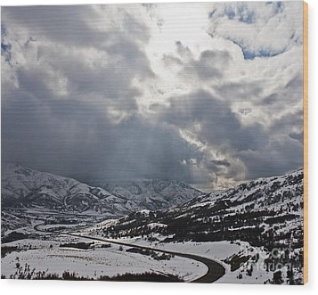 Road Through A Snowy Mountain Landscape Wood Print by Thom Gourley/Flatbread Images, LLC