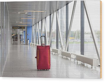 Rolling Luggage In An Airport Concourse Wood Print by Jaak Nilson