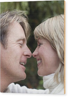 Smiling Couple Embracing Wood Print by Ian Boddy