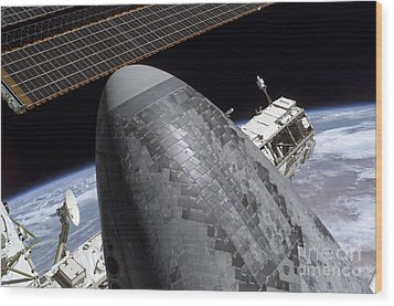 Space Shuttle Discovery Docked Wood Print by Stocktrek Images