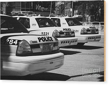 Toronto Police Squad Cars Outside Police Station In Downtown Toronto Ontario Canada Wood Print by Joe Fox