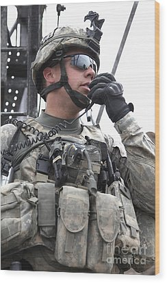 U.s. Army Soldier Communicates Wood Print by Stocktrek Images