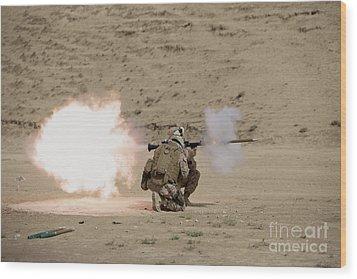 U.s. Marine Fires A Rpg-7 Grenade Wood Print by Terry Moore