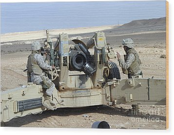 U.s. Marines Prepare To Fire A Howitzer Wood Print by Stocktrek Images