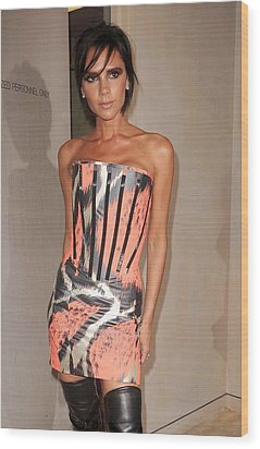 Victoria Beckham Wearing A Giles Dress Wood Print by Everett