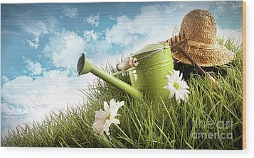 Water Can And Straw Hat Laying In Grass Wood Print by Sandra Cunningham