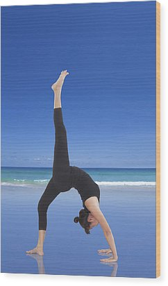 Woman Doing Yoga On The Beach Wood Print by Setsiri Silapasuwanchai