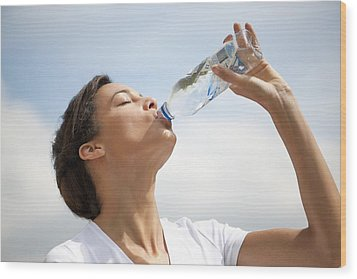 Woman Drinking Bottled Water Wood Print by