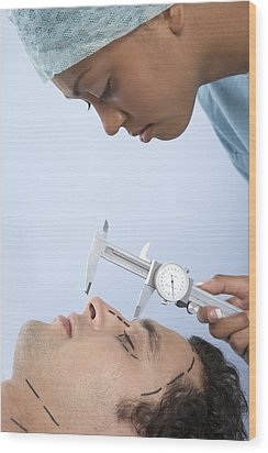 Cosmetic Surgery Wood Print by Adam Gault