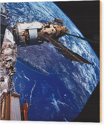 A Satellite Orbiting Above The Earth Wood Print by Stockbyte