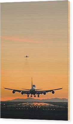 Aeroplane Landing, Canada Wood Print by David Nunuk