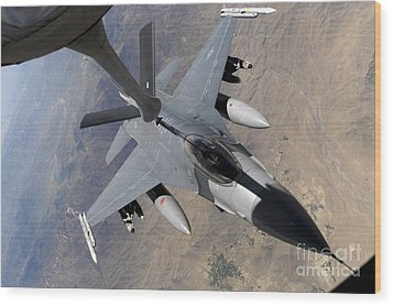 An F-16 Fighting Falcon Receives Fuel Wood Print by Stocktrek Images