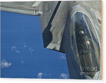 An F-22 Raptor In Flight Wood Print by Stocktrek Images