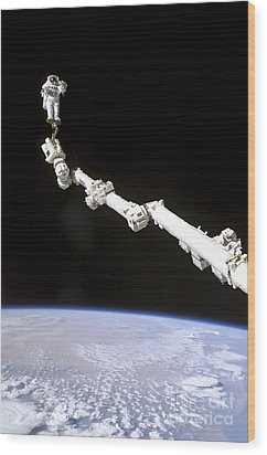 Astronaut Anchored To A Foot Restraint Wood Print by Stocktrek Images