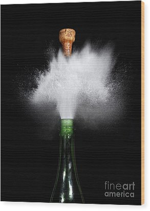 Champagne Cork Popping Wood Print by Ted Kinsman