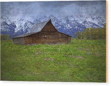 Grand Teton Iconic Mormon Barn Spring Storm Clouds Wood Print by John Stephens