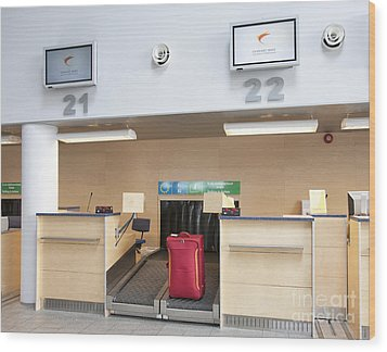 Luggage At An Airline Check-in Counter Wood Print by Jaak Nilson