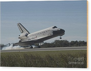 Space Shuttle Atlantis Touches Wood Print by Stocktrek Images