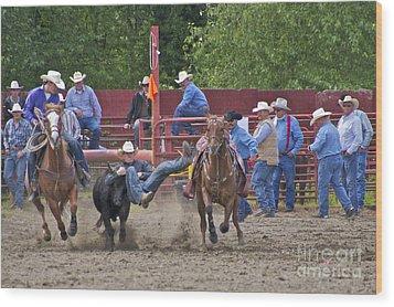 Steer Wrestler Wood Print by Sean Griffin