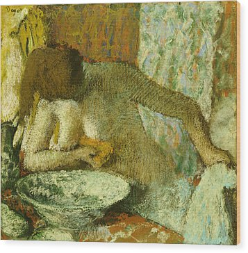 Woman At Her Toilet Wood Print by Edgar Degas