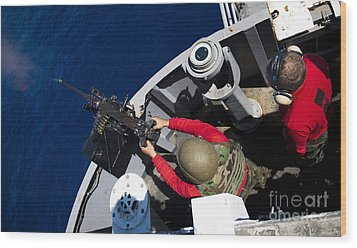 A Sailor Fires A .50-caliber Machine Wood Print by Stocktrek Images
