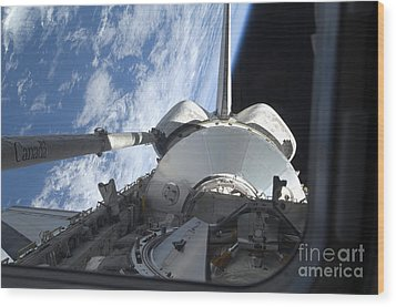 Space Shuttle Discovery Backdropped Wood Print by Stocktrek Images