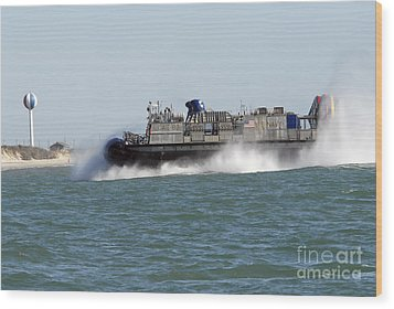 A Landing Craft Air Cushion Prepares Wood Print by Stocktrek Images