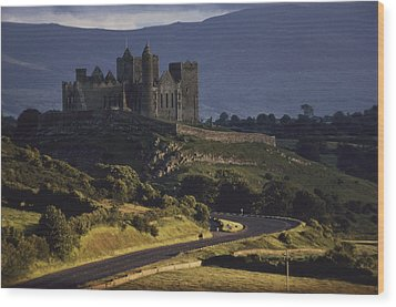 A Ancient Romanesque Castle Sits Atop Wood Print by Cotton Coulson