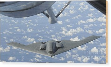 A B-2 Spirit Approaches The Refueling Wood Print by Stocktrek Images