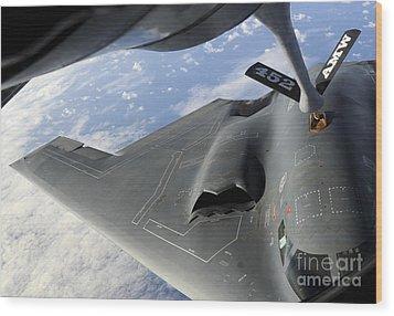 A B-2 Spirit Receives Fuel Wood Print by Stocktrek Images