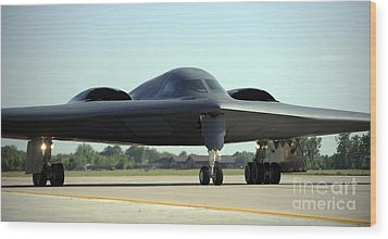 A B-2 Spirit Taxis Onto The Flightline Wood Print by Stocktrek Images