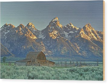A Barn In The Rocky Mountains Wood Print by Robbie George