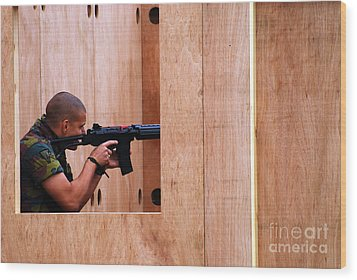 A Belgian Soldier Trying Out A Shooting Wood Print by Luc De Jaeger