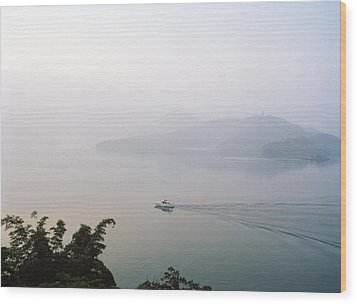 A Boat Cuts Into The Still Waters Wood Print by Justin Guariglia