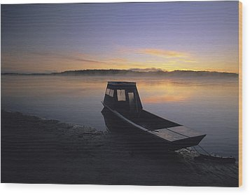 A Boat Sits On The Calm Yukon River Wood Print by Michael Melford