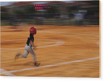 A Boy Runs During A Baseball Game Wood Print by Raul Touzon