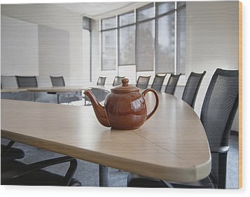 A Brown China Teapot On Boardroom Table Wood Print by Marlene Ford