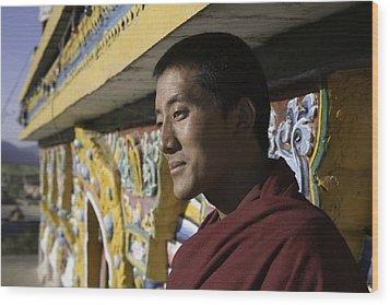 A Buddhist Monk Near The Edge Wood Print by David Evans