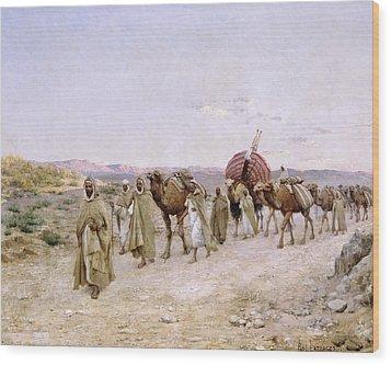 A Caravan Near Biskra Wood Print by PJB Lazerges