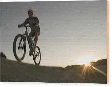 A Caucasian Man Mountain Bikes Wood Print by Bobby Model