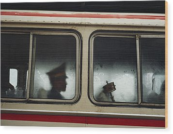 A Chinese Pla Soldier Sits On A Bus Wood Print by Justin Guariglia