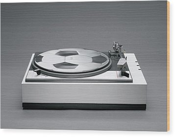 A Disk With A Soccer Print On A Record Player Wood Print by Benne Ochs