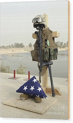 A Fallen Soldiers Gear Display Wood Print by Stocktrek Images