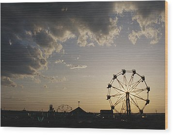 A Ferris Wheel Is Silhouetted Wood Print by Stephen Alvarez