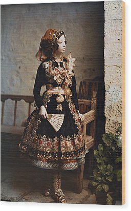 A Girl Poses In Her Traditional Costume Wood Print by Gervais Courtellemont